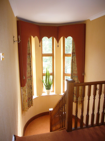 Stairwell curtains with shaped pelmets